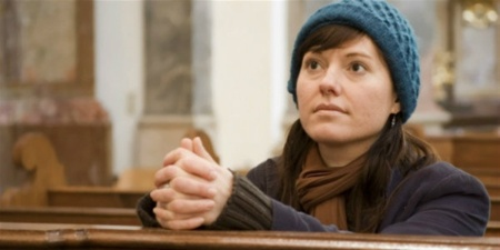 11013-woman-in-church-praying-1200w-tn